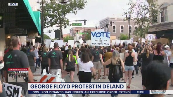 Protesters, police officers jion in DeLand demonstrations