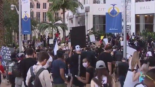 Protesters travel across Orlando