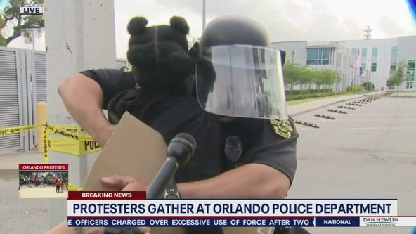 Orlando police officer, protester have heart-to-heart moment