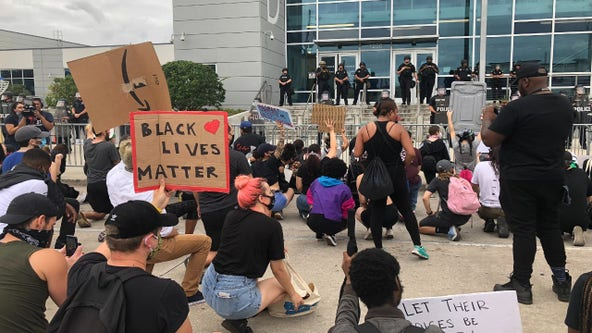 Protesters gather at OPD Headquarters ahead of 8 p.m. curfew, second group assembles at Lake Eola