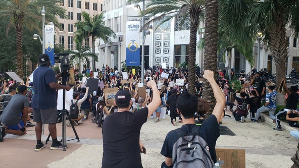 Protesters converge peacefully on the steps of Orlando City Hall