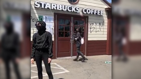 'It is never OK to commit a crime in our honor': Black protesters confront women vandalizing Starbucks