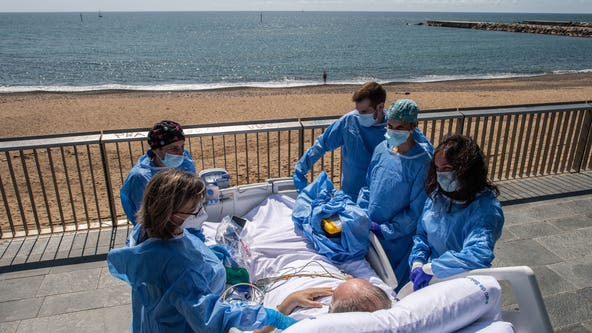 Hospital staff in Spain wheels recovering coronavirus patients to the beach
