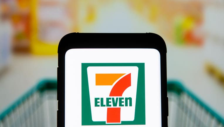 In this photo illustration a 7 Eleven logo seen displayed on