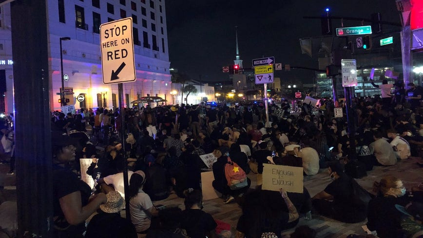 Protesters outside Orlando City Hall met with tear gas as officers dodge flying water bottles, other debris