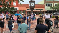 Demonstrators gather in Sanford to protest Seminole County mask order