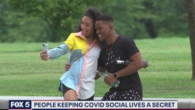 Some people keeping COVID-19 social lives a secret, according to new survey