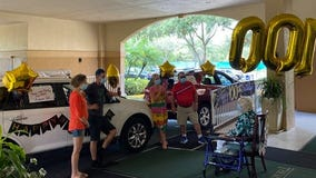 Family surprises Winter Park senior for 100th birthday with drive-thru parade