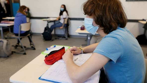 CDC recommends all schools continue to use masks
