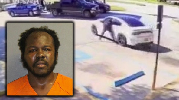 Video shows victims clinging to car as man steals vehicle with child in backseat, Florida police say