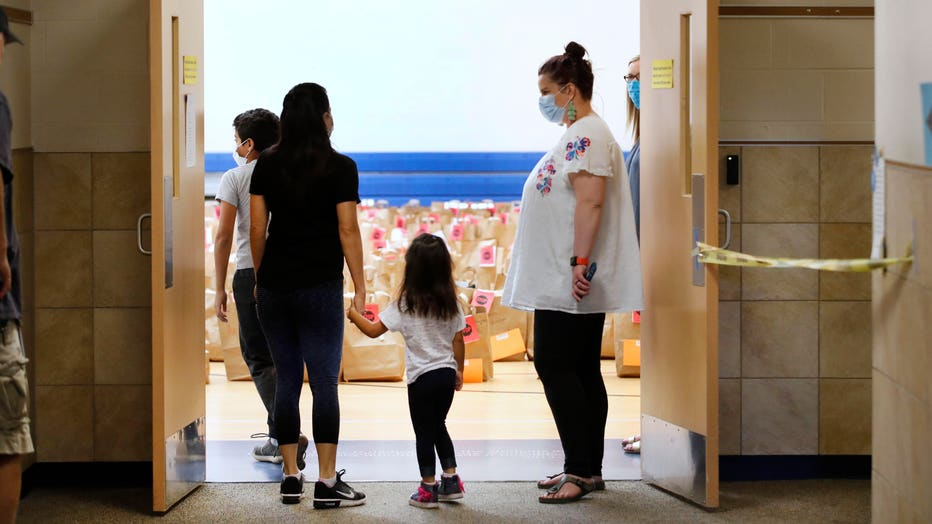 Students Pick Up Personal Belongings As Teachers Clean Out Classrooms At End Of Pandemic-Impacted School Year