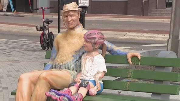 Wax statue placed in Orlando to show effects of climate change