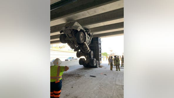 Trucker rescued after vehicle gets stuck under Central Florida overpass