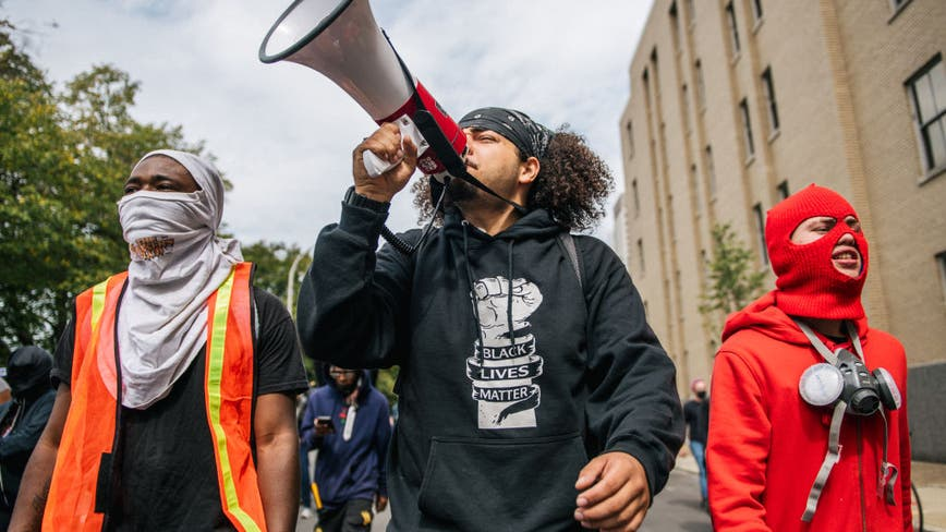 Breonna Taylor: Riot police square off with protesters in Louisville, set off flash bangs