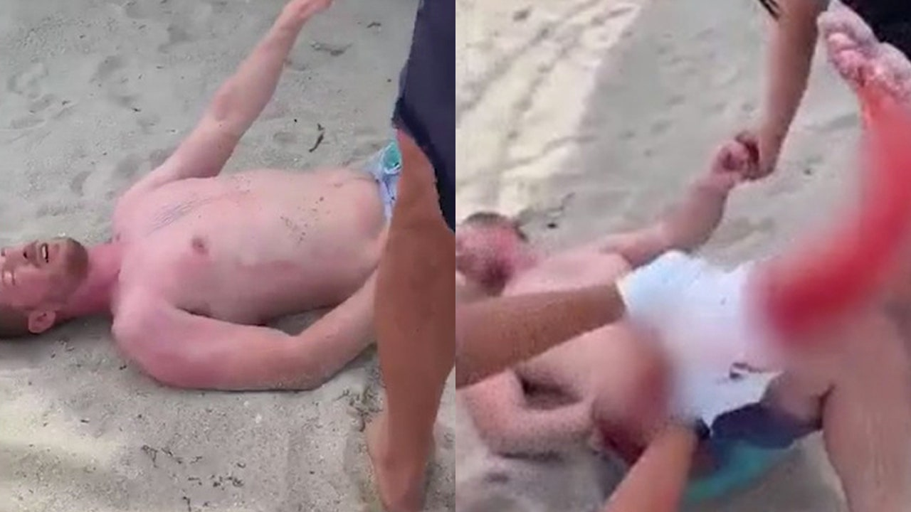 Tourist survives shark attack at Florida beach, video shows