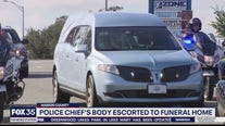 Police chief's body escorted to funeral home