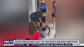 Mom dragged out of school board meeting
