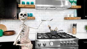 Real estate agent decorates homes with giant skeletons to drum up exposure