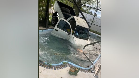 Truck crashes through patio, lands in swimming pool in Kissimmee