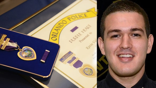 Officer Kevin Valencia receives purple heart, shows signs of improvement