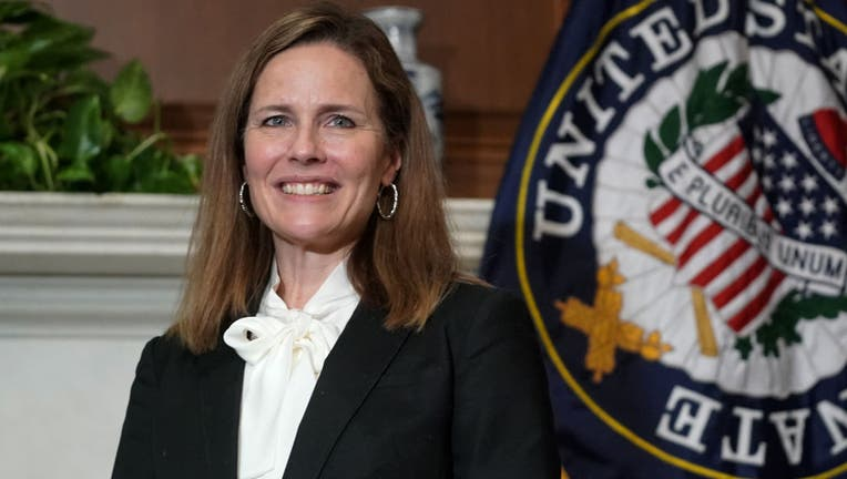 FILE - Seventh U.S. Circuit Court Judge Amy Coney Barrett, President Donald Trump's nominee for the U.S. Supreme Court, meets with Sen. Bill Cassidy (R-LA) as she prepares for her confirmation hearing, on Capitol Hill on October 1, 2020 in Washington, DC.