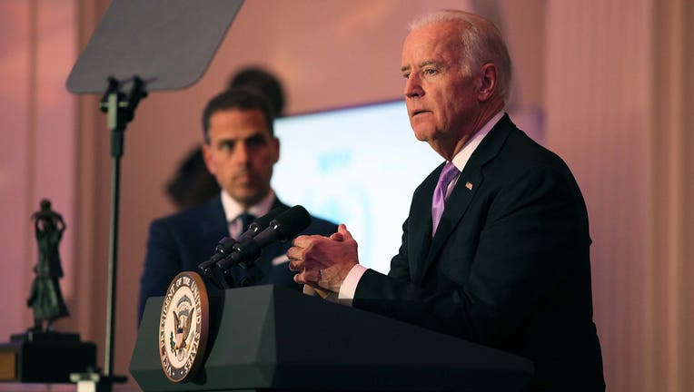 Hunter Biden (L) and Vice President Joe Biden speak on stage at the World Food Program USA's Annual McGovern-Dole Leadership Award Ceremony at Organization of American States on April 12, 2016 in Washington, D.C. (Photo by Teresa Kroeger/Getty Images for World Food Program USA)
