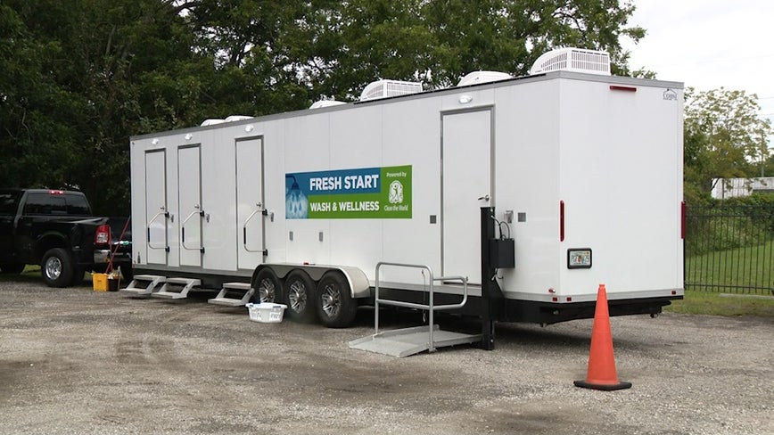 Clean the World builds mobile shower unit to fight COVID-19