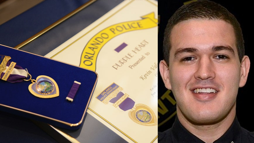 Officer Kevin Valencia receives purple heart, is showing signs of improvement