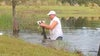Caught on video: Man saves puppy from alligator's jaws in Florida