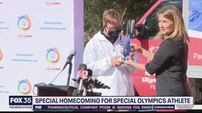Homecoming for Special Olympics athlete who made history