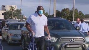 NBA legend Magic Johnson provides Thanksgiving meals for Orlando families