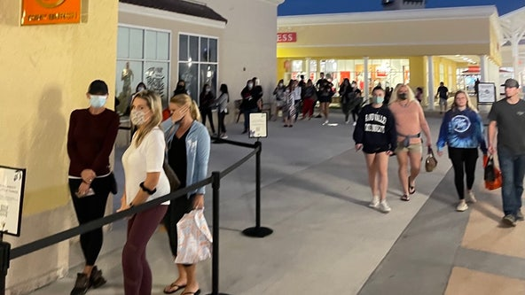 Shoppers line up for Black Friday deals despite COVID-19 changes