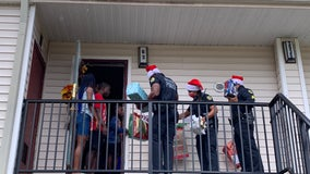 Orlando police officers deliver toys to children