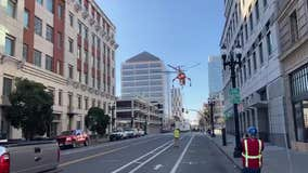 Helicopter drops huge A/C unit onto Oakland street