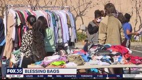 Teacher organize distribution of Blessing Bags