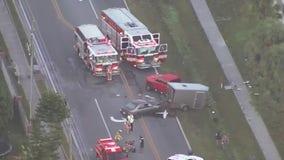 FHP: 1 dead, 3 injured after vehicle strikes trailer, pedestrians