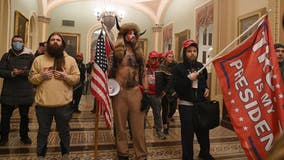 Marketing firm fires worker after he was photographed wearing company badge at pro-Trump US Capitol riot