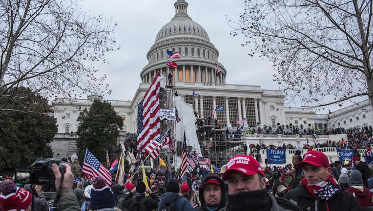 FILE - US President Donald Trump's supporters gather outside the Capitol building.