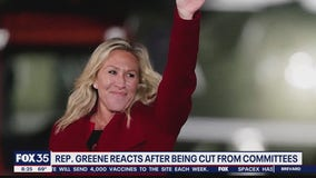 Rep. Greene reacts after being cut from committees