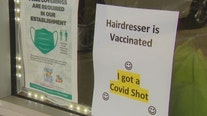 Florida hairstylist hangs 'hairdresser is vaccinated' sign to welcome customers back in