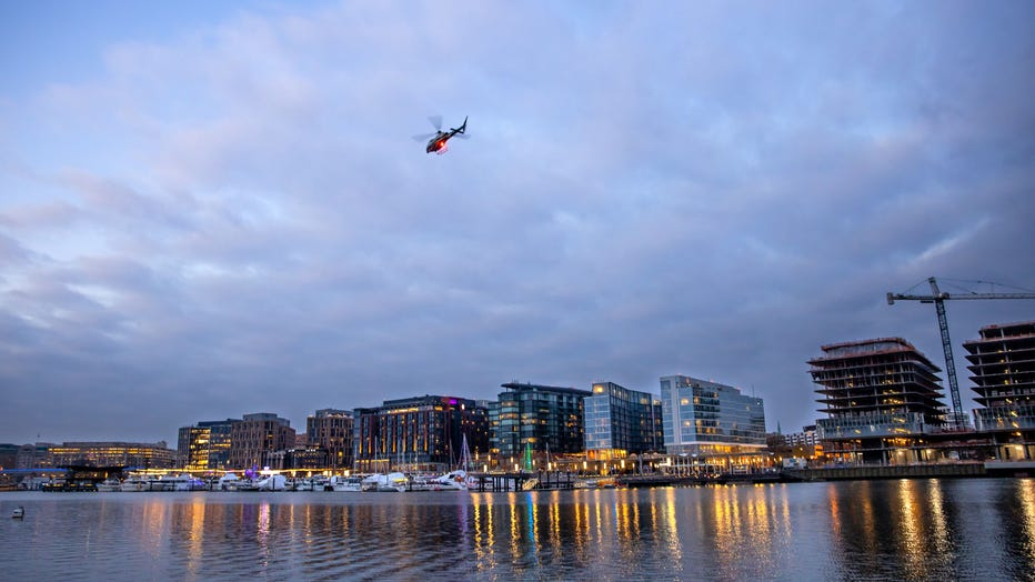 WASHINGTON,DC-DEC18: A helicopter from Fort Mc Nair flies over