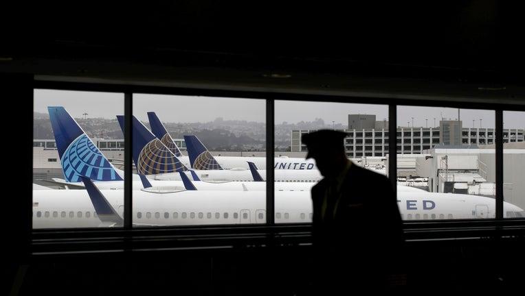 49c1e9c4-San Francisco Airport Terminal Serves Very Few Passengers During COVID-19 Pandemic
