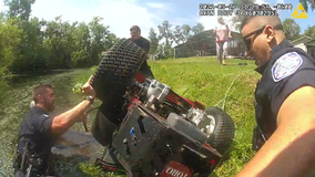 Florida police officers save man pinned under lawnmower in pond