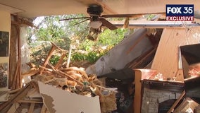 FOX 35 EXCLUSIVE: Woman rescued from mobile home after large tree fell on it