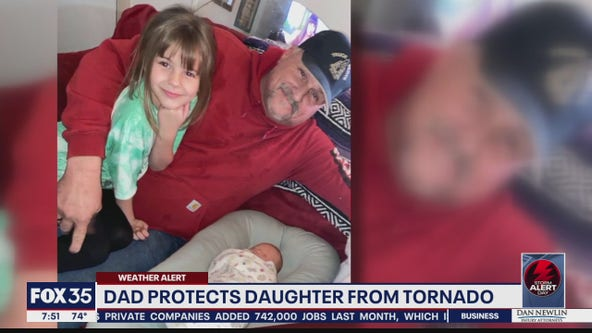 Dad protects daughter from tornado