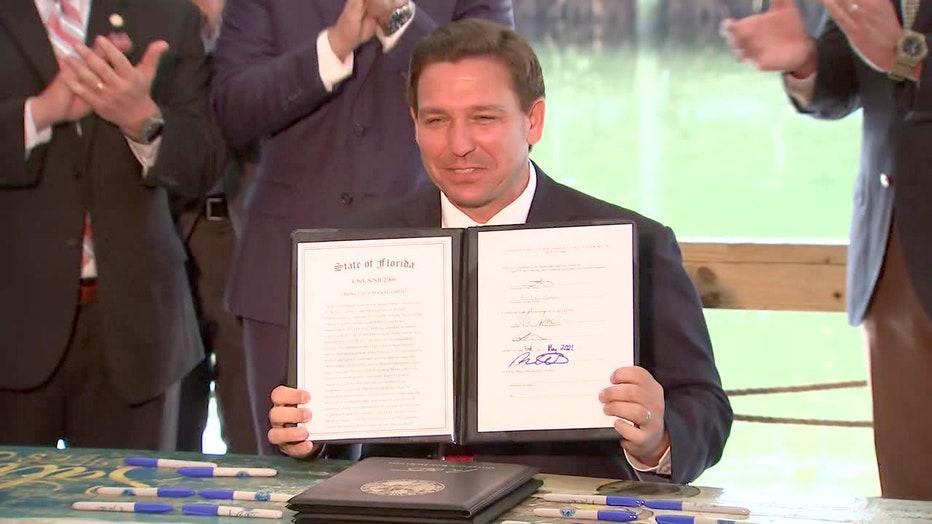 desantis signs passport ban