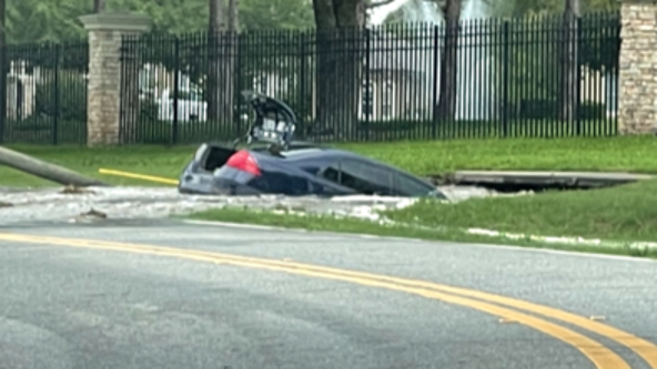Troopers: Car swallowed by hole after hitting fire hydrant