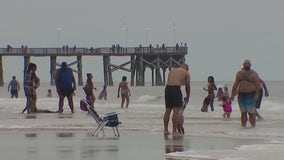 Holiday crowds flock to Florida beaches despite incoming tropical storm