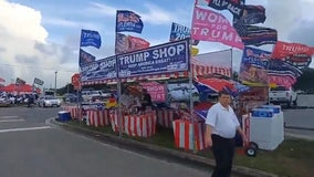 Supporters display 'Trump 2024' signs ahead of Florida rally