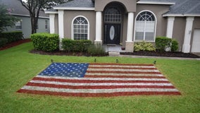 Central Florida resident celebrates 4th of July with patriotic lawn painting